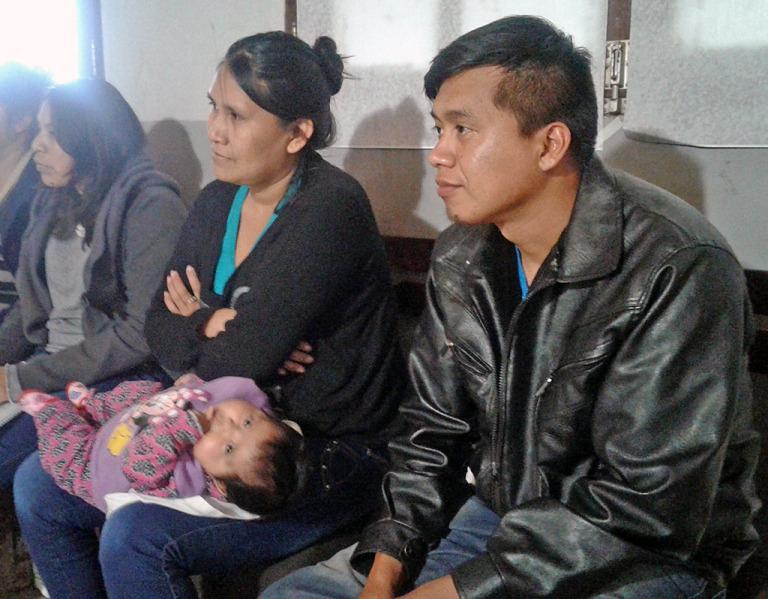 Genitori con bambino Qom
